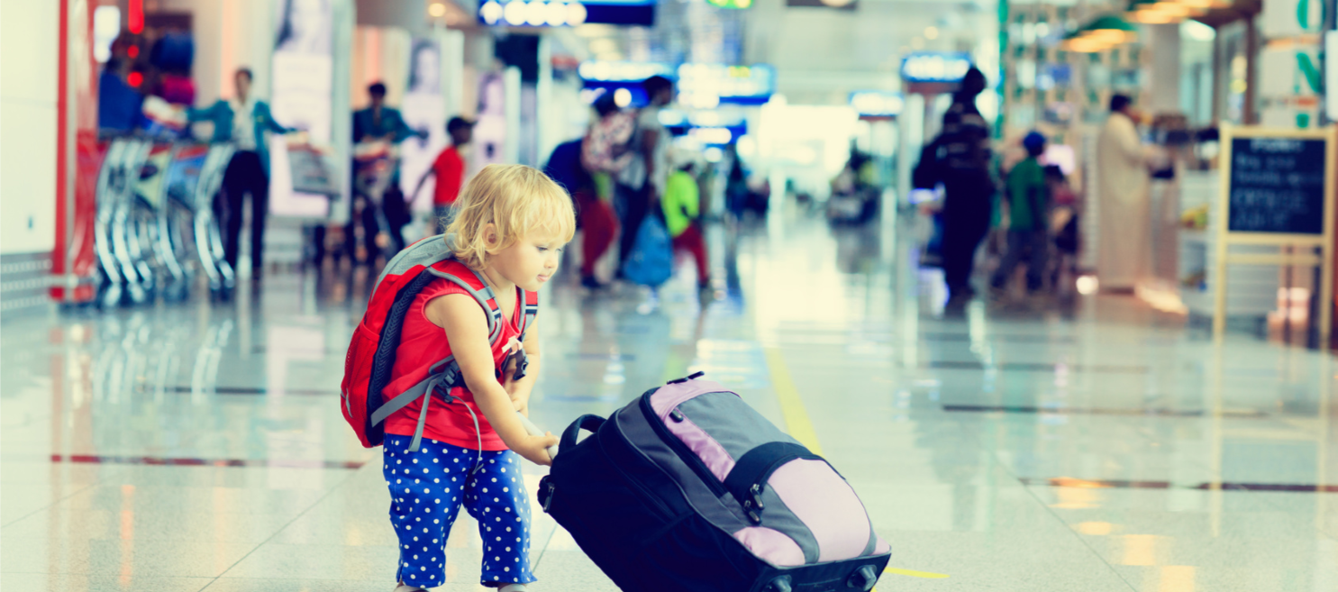 toddler-pulling-suitcase-in-airport