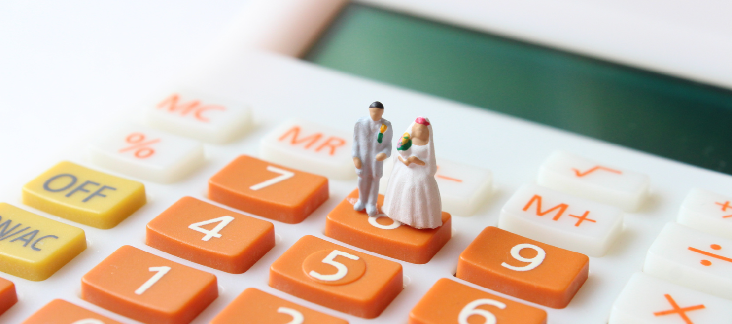 bride-groom-wedding-cake-topper-on-calculator