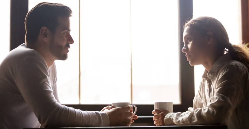 A couple has a serious discussion over coffee