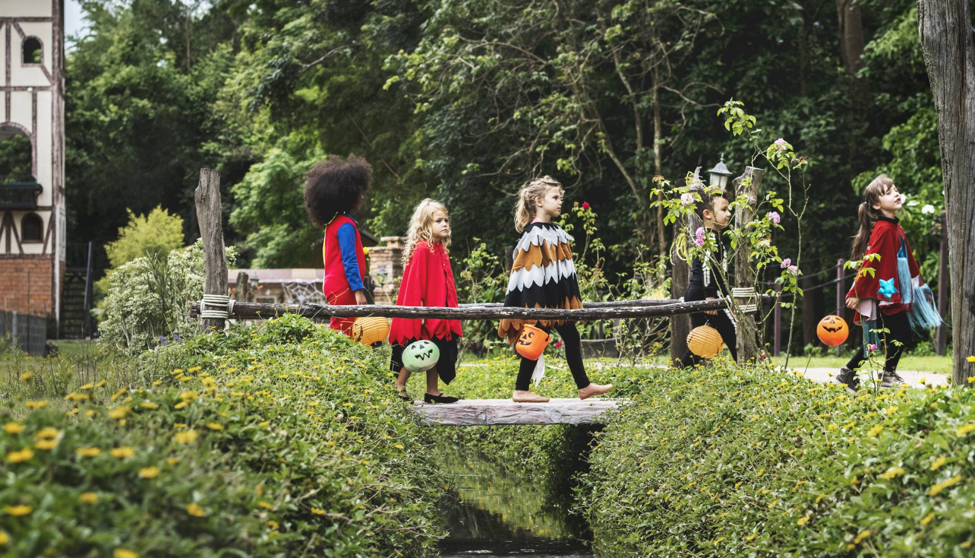 Kids walking on Halloween wearing costumes carrying candy, trick-or-treating - LawDepot